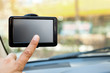 finger pointing at car GPS