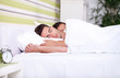 Morning, young couple in bed