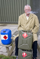 Man smoking near petrol cans