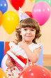 pretty girl  with colorful balloons and gift