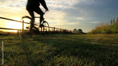Bicyclers during sunset