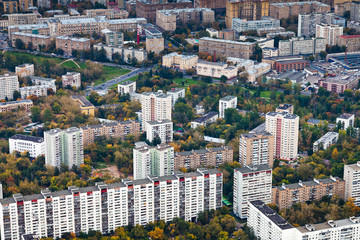 block of big modern houses in autumn day