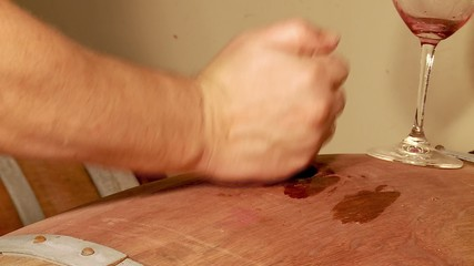 Sampling red wine from the oak barrel