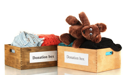 Donation boxes with clothing isolated on white