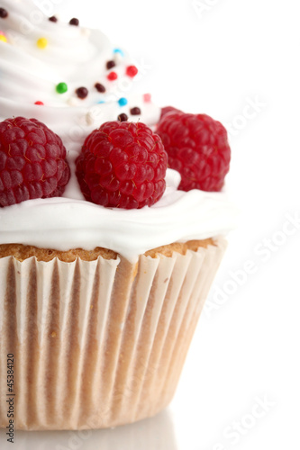 tasty cupcake with berries, isolated on white