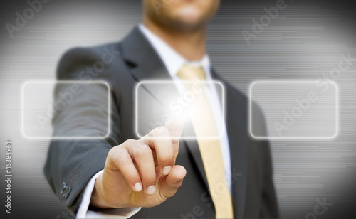 Businessman touching digital screen