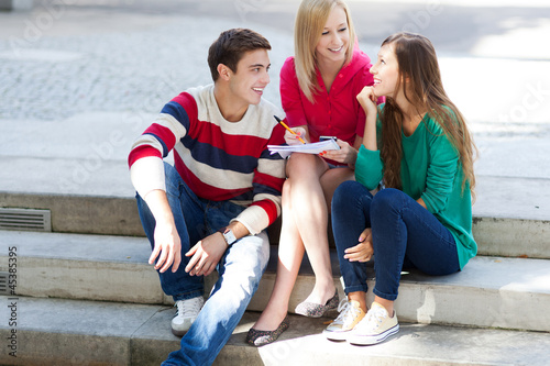 Three students sitting together