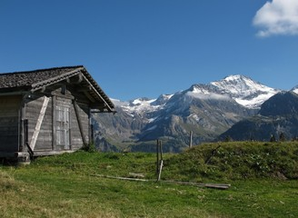 Mountains And Old Shed With Timber Roof