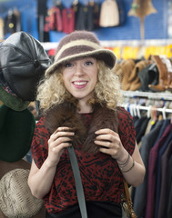hat shopping in a thrift store