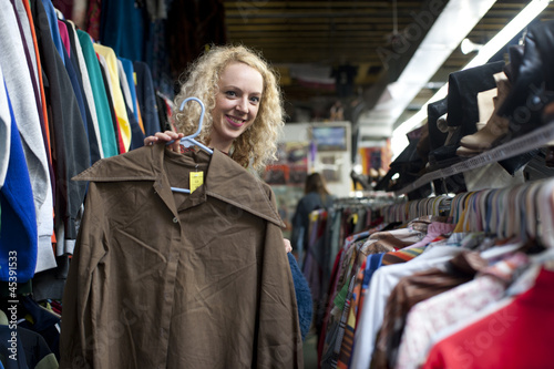 smiling girl with funny shirt at thrift store