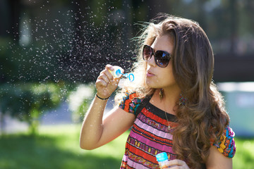 Young girl and bursting of bubble
