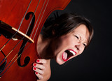 Girl face screaming by double bass