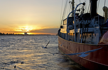 Boat moored at sunset