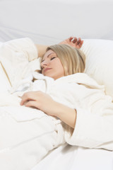 young woman sleeping with outstretched hands