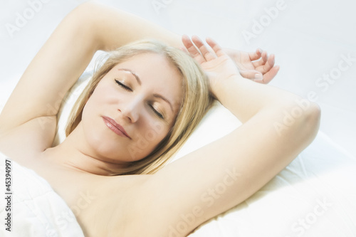 woman having a sleep with a smile on her face