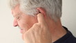 older man suffering from pain deep in his ear