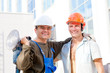 Two positive industrial workers in uniforms and protective gears