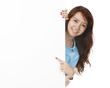 Woman Pointing At Blank Wall