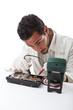 Technician repairing a hard disk
