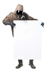 Man in Hazard Suit holding a billboard and looking at it