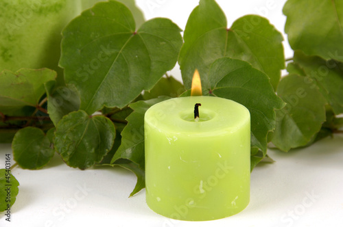 burning candle Green candle and ivy © camellias