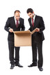 Two Businessman looking inside a box