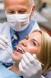 White teeth woman patient at the dentist
