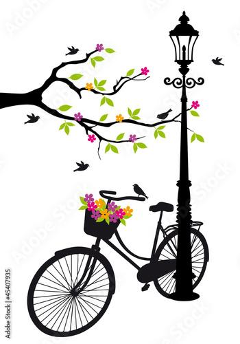 rower-z-lampa-kwiatami-i-drzewa-wektor