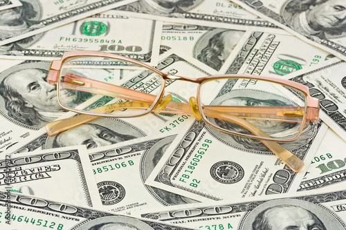 Glasses on money