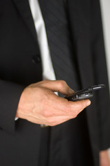 Closeup of a business man using his cell phone.