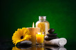 Spa still life with sea salts candles flower towel and stones