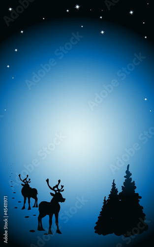 winter background with reindeer silhouettes
