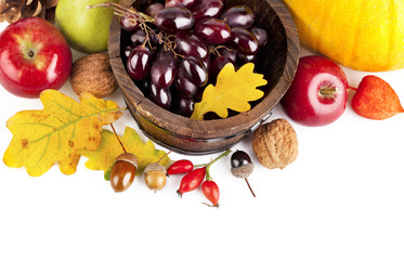 autumnal harvest fruits and vegetables with yellow leaves