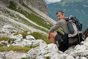 Man having a rest in Dolomites, Italy.