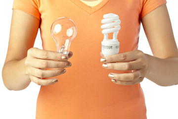 human hand holding two different kinds of light bulbs