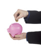 human hand holding coin over pink piggy bank