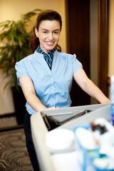 Housekeeping executive pushing the cart