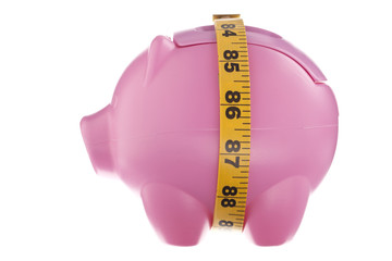 pink piggy bank with tape measure