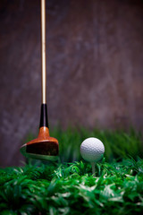 golf driver and golf ball on green grass