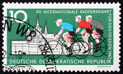 Postage stamp GDR 1962 Cyclists and Hradcany, Prague