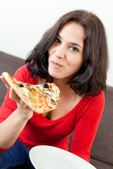 Brunette eating a pizza