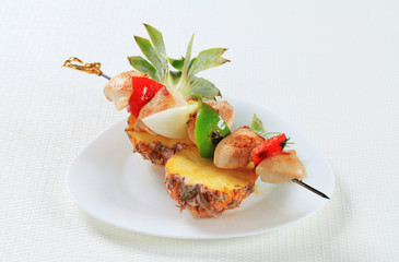 Chicken skewer and fresh pineapple
