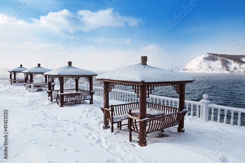 Arbours on the shore of lake Baikal, a winter landscape, Siberia