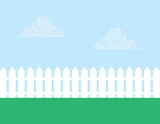 White picket fence with cloudy sky