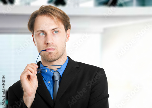 Pensive businessman in his office