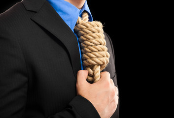 Businessman with a rope in place of a collar: tax pressure