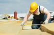 canvas print picture - roofer worker measuring insulation material