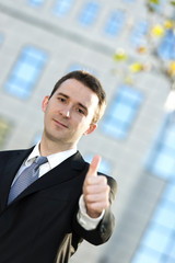 Business man showing thumbs up