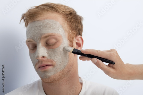 Man's facial cosmetic treatment.
