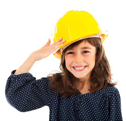 Little girl wearing yellow helmet salute